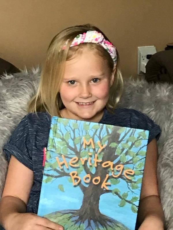 Next, I sent the book on to my cousin in New York since it had been customized for her daughter Lilli. And the reaction? They both LOVED IT! Look at the photo below and you'll see Lilli enjoying her new My Heritage Book.